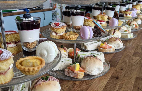 Afternoon Tea stands waiting to be served at a party.